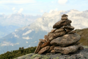 "Memorial stones on mountain top stating ""I made it!"" - a common sighting all over the world."